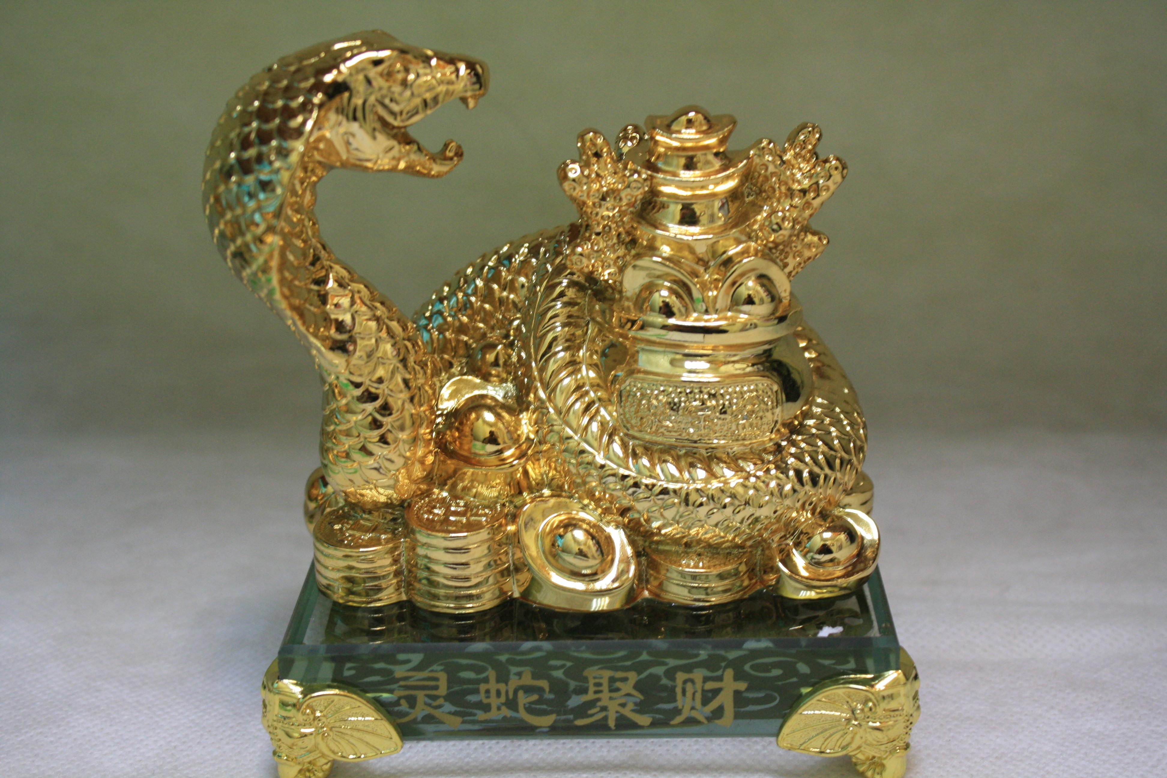 символ богатства - трехногая жаба